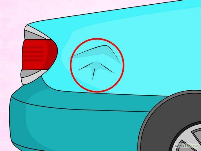 La eliminación de pequeñas abolladuras en el coche utilizando un secador de pelo