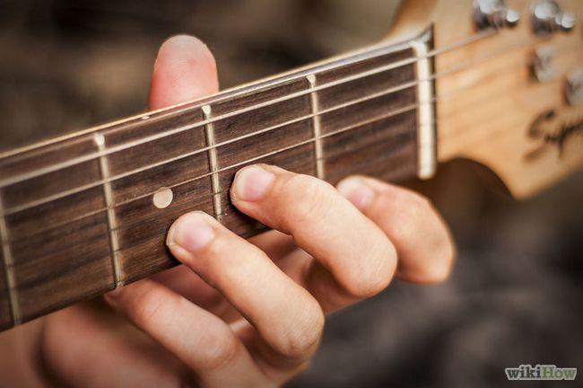 Cómo jugar a un menor de edad d en una guitarra