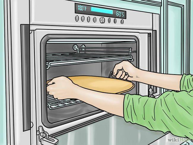Cómo utilizar una piedra de la pizza